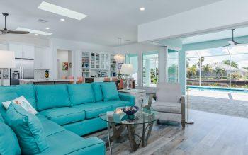 Living room with wood-look luxury vinyl floors looking out sliding glass doors